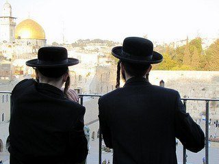 Two chareidi young men looking at the Kotel